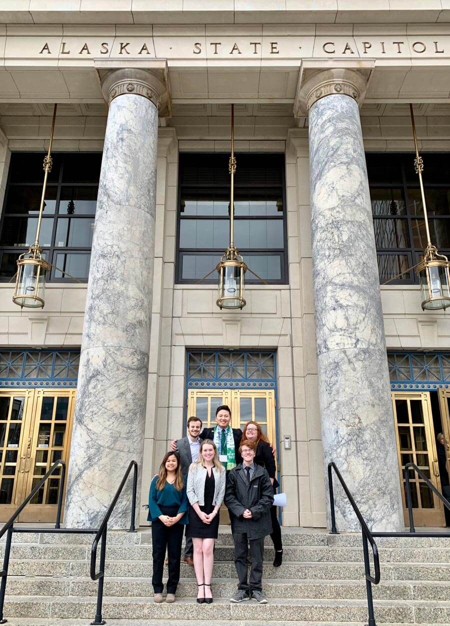 Student leaders pose in front of Alaska capitol